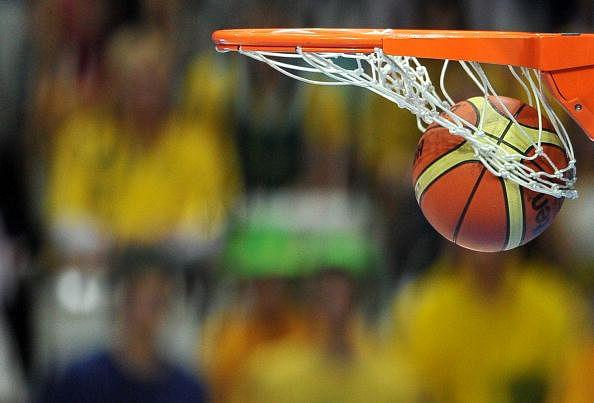 A ball goes into a basket as Australia s