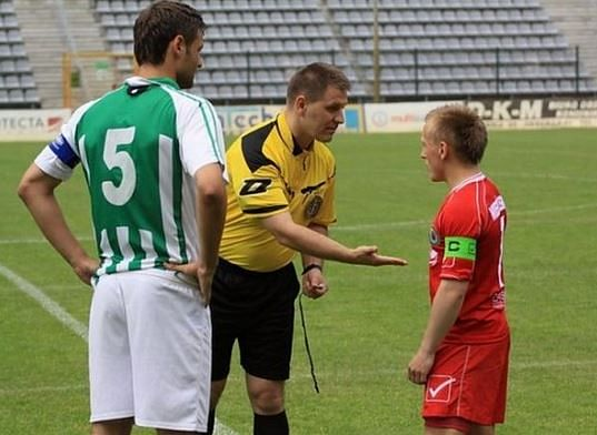 MarcinGaruch(R) seen not shaking the hand offered by the referee
