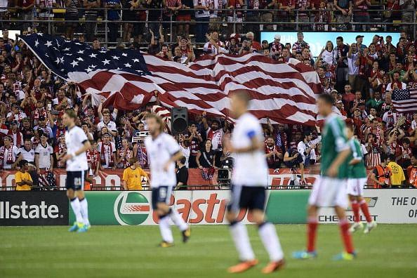 Fans unfurl a large U.S. flag after the U.S. Men