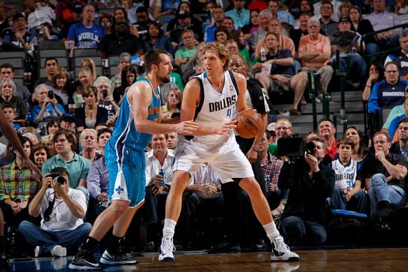 Dirk Nowitzki #41 of the Dallas Mavericks posts up against Ryan Anderson #33 of the New Orleans Hornets