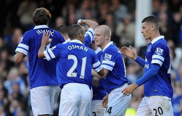 Steven Naismith of Everton celebrates wit his team-mates after scoring the opening goal during the Barclays Premier League match between Everton and Chelsea at Goodison Park