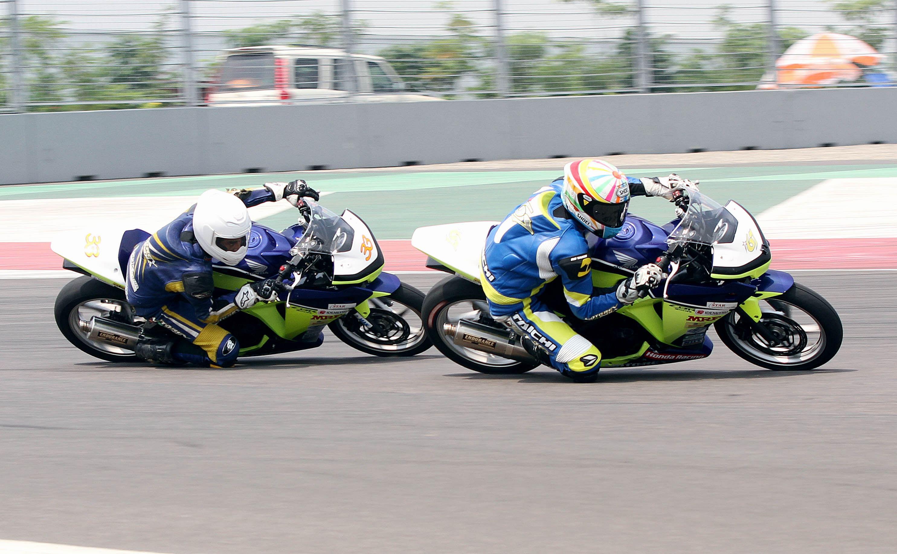 K Rajini (front) on way to winning Honda CBR Race