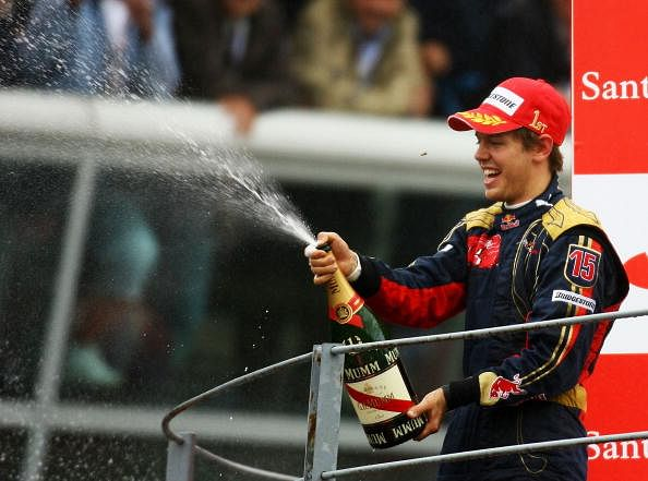 Sebastian Vettel of Germany and Scuderia Toro Rosso celebrates on the podium after winning the Italian Formula One Grand Prix at the Autodromo Nazionale di Monza on September 14, 2008 in Monza, Italy.  (Getty Images)