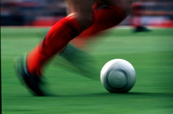 Stock Photography: Football. 13th April 1997. A close-up football illustration of a players feet whilst running with the ball, the ball is shown in motion by the panning shot at the FA. Cup. Semi Final at Highbury during the Wimbledon v Chelsea game of wh