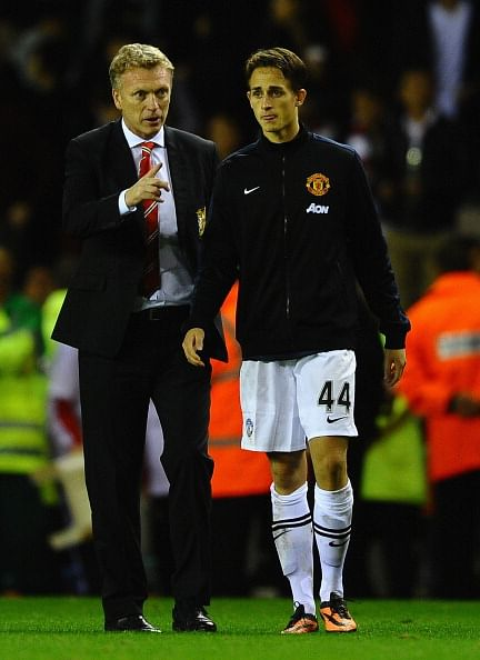 Adnan Januzaj(R) hammered home two goals after being given his first start by David Moyes(L)