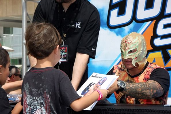 Kids meet Superstar Rey Mysterio at a recent WWE event
