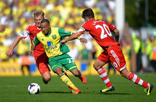 Nathan Redmond (C) battles with James Ward-Prowse (L) and Adam Lallana (R) during the Barclays Premier League match between Norwich City and Southampton at Carrow Road on August 31, 2013 in Norwich, England.  (Getty Images)