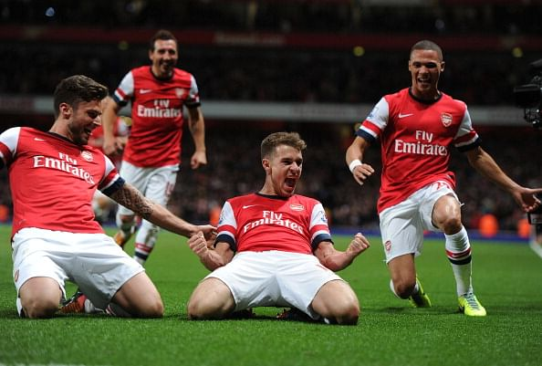 LONDON, ENGLAND - NOVEMBER 02: Aaron Ramsey (2L) celebrates scoring the second Arsenal goal with team mates Olivier Giroud (L) and Kieran Gibbs (R) during the Barclays Premier League match between Arsenal and Liverpool at Emirates Stadium on November 02, 2013 in London, England.
