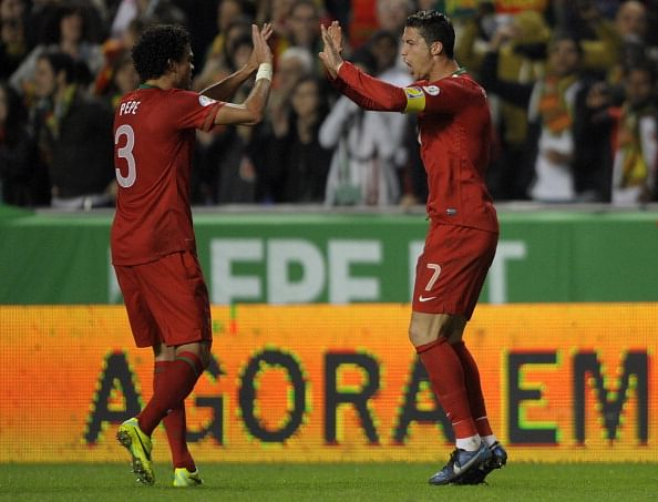 Cristiano Ronaldo (R) celebrates with Pepe after scoring the only goal of the game