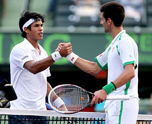 Somdev and Djokovic after their third round encounter at Miami.