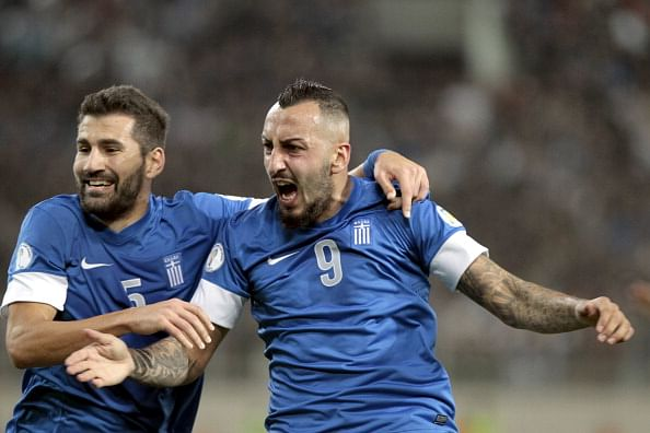 Konstantinos Mitroglou celebrates with his teammate Dimitris Siovas after scoring