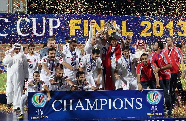 Kuwait SC players celebrate with the trophy after winning the AFC Cup final