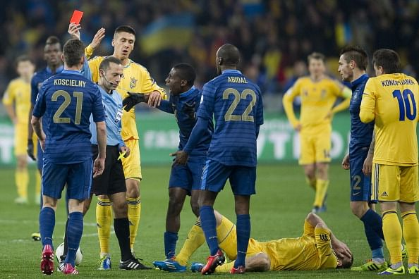 Laurent Koscielny is shown a red card by referee Cuneyt Cakir of Turkey