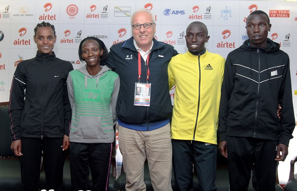 At the International Elite Athletes Meet & Greet at the Media Center of the AIrtel Delhi Half Marathon in Jawaharlal Nehru Stadium on Thursday (L to R), Meseret Hailu from Ethiopia, Lucy Kabuu from Kenya, Jos Hermans (International Elite Athletes Co-ordinator), Defending Champion Edwin Kipyego from Kenya and World's fastest Man Geoffrey Kipsang from Kenya.