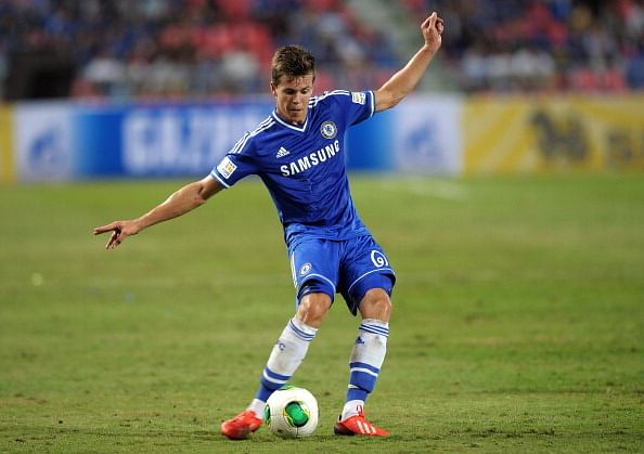 Chelsea football player Marco Van Ginkel controls the ball during the exhibition match at Rajamangala National stadium in Bangkok on July 17, 2013.  Chelsea beat Singha All Star 1-0.   AFP PHOTO / PORNCHAI KITTIWONGSAKUL        (Photo credit should read PORNCHAI KITTIWONGSAKUL/AFP/Getty Images)