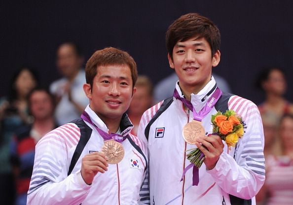 Lee Yong-Dae (right) and Jae Sung Chung of Korea stand with their Bronze medals following the Men