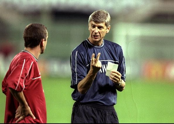 14 Sep 1999:  Arsenal manager Arsene Wenger with Nigel Winterburn  during training for the UEFA Champions League group B match against Fiorentina at the Stadio Communale in Florence, Italy. The game ended goalless.  Mandatory Credit: Mark Thompson /Allsport