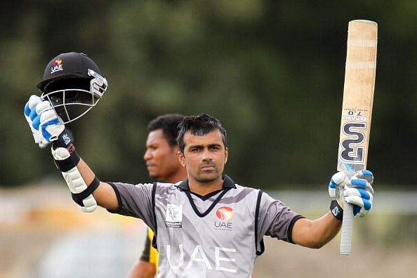 CHRISTCHURCH, NEW ZEALAND - JANUARY 26: Khurram Khan of UAE celebrates as he reaches his century during the ICC Cricket World Cup Qualifier match between UAE and PNG at Hagley Oval on January 26, 2014 in Christchurch, New Zealand. (Photo by Martin Hunter-IDI/IDI via Getty Images)
