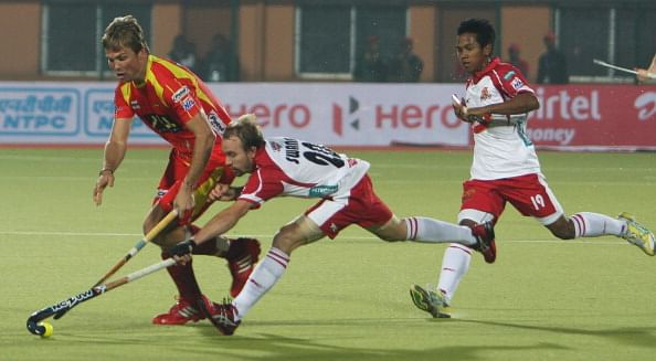 Mumbai Magicians (white & red jersey) in action during the Hockey India League Season 1