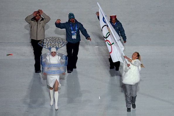 Indian Olympic Participants (IOP), alpine skier Himanshu Thakur (R), cross-country skier Nadeem Iqbal (C) and luger Shiva Keshavan (L), enter during the Opening Ceremony of the Sochi Winter Olympics at the Fisht Olympic Stadium on February 7, 2014 in Sochi.