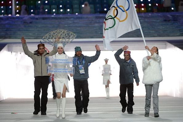 (From left to right) Shiva Keshavan, Nadeem Iqbal and Himanshu Thakur walking under the Olympic flag during the Sochi 2014 opening ceremony