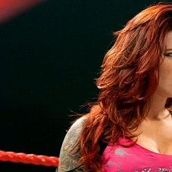 Trish Stratus congratulates Lita on the WWE Hall of Fame
