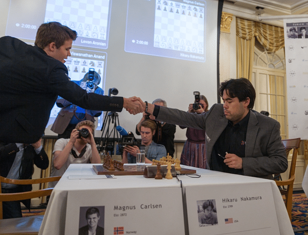 MANIMAL MAGNUS: World Chess Champion Magnus Carlsen and US #1 Hikaru Nakamura before their blood-spilling, gut-wrenching showdown. Who could guess? The Norwegian would be outplayed, smothered and destroyed..., but live to have the last laugh!  Photo: Maria Emelianova