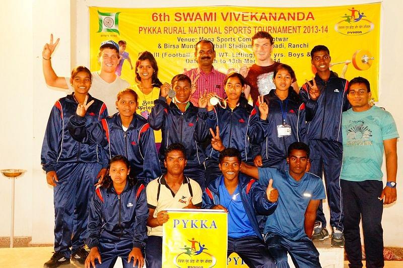 Back Row: Sebastian Gerl ( Khel Vikas WL Coach), Chandini (Odisha State Girl's Rep), Dharma Rao (Odisha State Boy's Rep), Cormac Whelan (Khel Vikas Head Coach), Ajay Mallik. Middle Row: Puni Raita, Kanchana Badamundi (Leadership Trainee), Prashanta Badamundi, Pinki Nayak, Anita Behera, Prasad Mohanty (Khel Vikas Community Support Officer). Front Row: Jyoti Badamundi, Sanatana Mallik, Ashwin Kumar Naik, Bidiya Dhar Sahu.