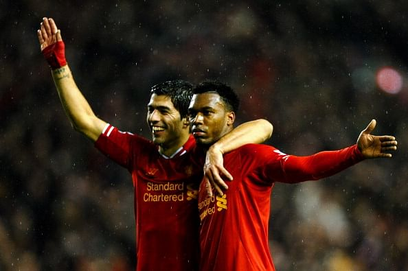 Daniel Sturridge (R) of Liverpool is congratulated by teammate Luis Suarez (L) after scoring his team