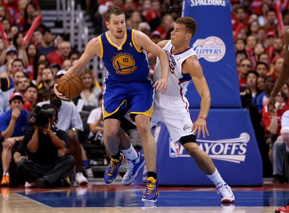 David Lee #10 of the Golden State Warriors copntrols the ball against Blake Griffin #32 of the Los Angeles Clippers in Game One of the Western Conference Quarterfinals during the 2014 NBA Playoffs at Staples Center on April 19, 2014 in Los Angeles, California. The Warriors won 109-105