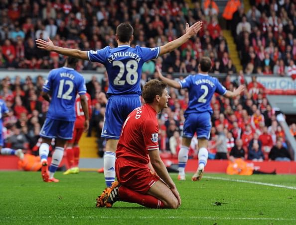 Chelsea celebrate, as a devastated Steven Gerrard looks on
