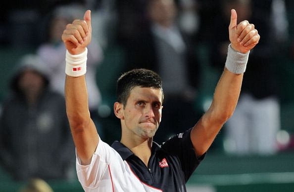 Novak Djokovic celebrates after winning his Monte-Carlo match against Guillermo Garcia-Lopez