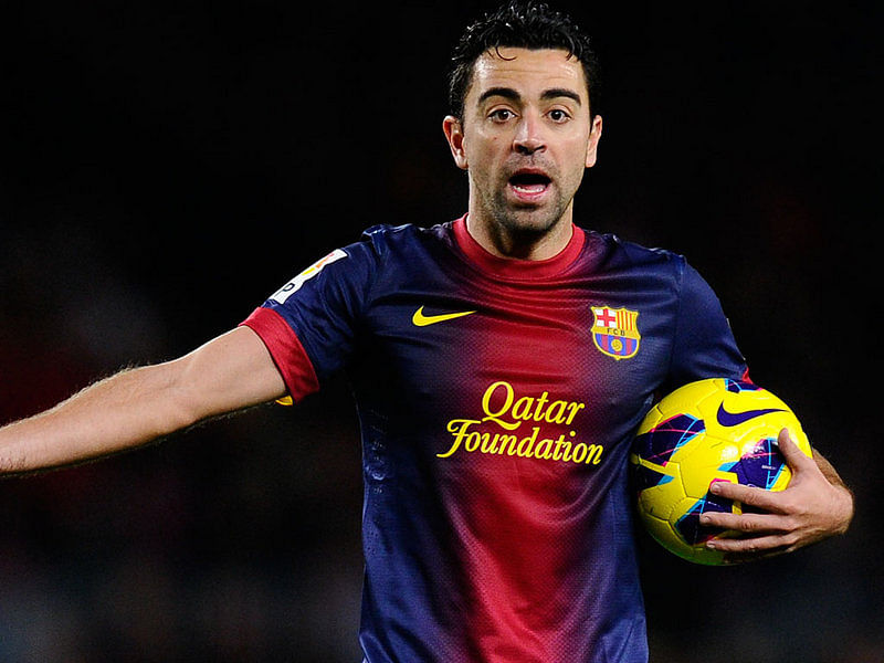Xavi has been dictating play for Barcelona and Spain