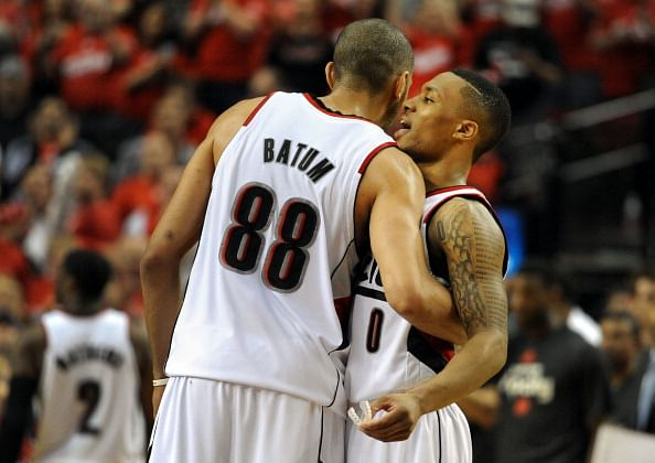 Nicolas Batum #88 of the Portland Trail Blazers greets Damian Lillard #0 of the Portland Trail Blazers after Game Four of the Western Conference Semifinals against the San Antonio Spurs during the 2014 NBA Playoffs at the Moda Center on May 12, 2014 in Portland, Oregon. The Blazers won the game 103-92.