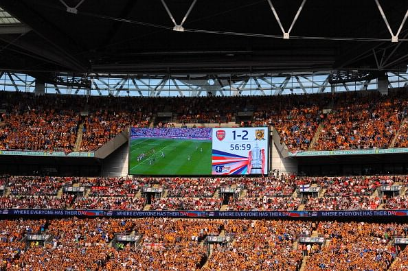 Fans applaud during the 56th minute of the match in memory of the 56 people who lost their lives in the Bradford City stadium fire during the FA Cup with Budweiser Final match between Arsenal and Hull City at Wembley Stadium on May 17, 2014