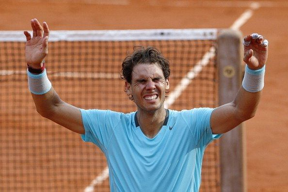 Rafael Nadal celebrating after winning the 2014 French Open