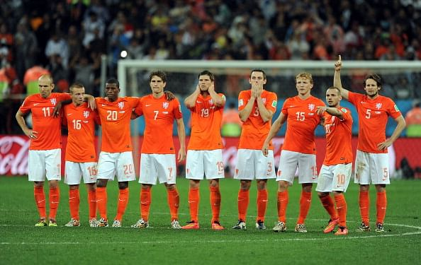 The Netherlands team look on during the penalty shoot out