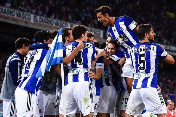 Carlos Vela Garrido (L) of Real Sociedad celebrates with his teammates after scoring his team