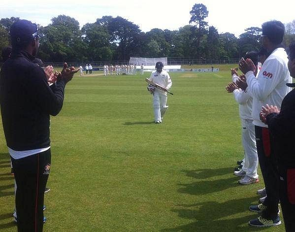 Khurram Khan receives a guard of honour from teammates after his final international innings against Ireland
