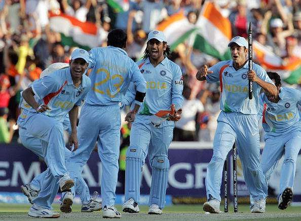 MS Dhoni celebrates with Joginder Sharma after the win over Pakistan in the final