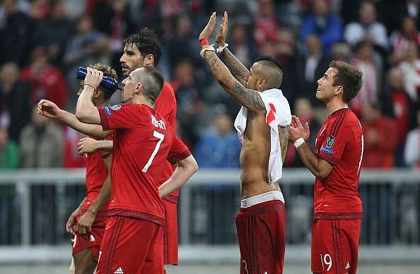 Bayern Munich players celebrate after winning the first leg against Benfica