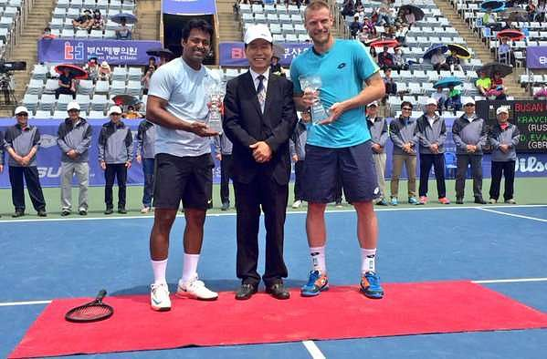 Leander Paes (left) and Sam Groth (extreme right) with their trophies at busan on Sunday (image courtesy: Leander Paes Twitter)