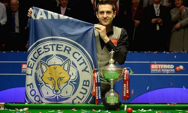 Mark Selby celebrates his world title and Leicester City