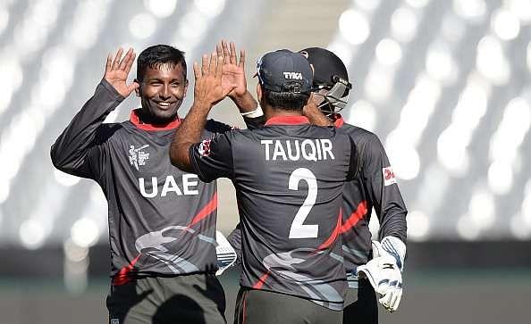 Krishna Chandran celebrates with his UAE teammates