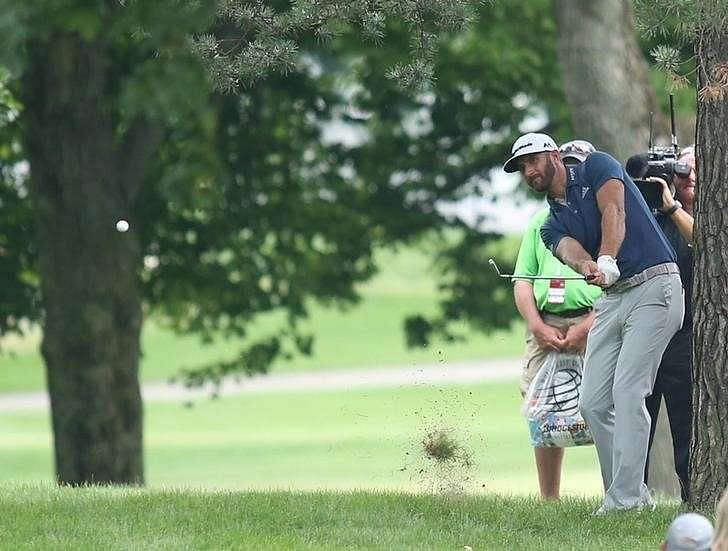 Jul 3, 2016; Akron, OH, USA; Dustin Johnson of the United States hits out of the trees on the sixteenth hole during the final round of the 2016 Bridgestone Invitational at Firestone Country Club - South Course. Mandatory Credit: Charles LeClaire-USA TODAY Sports