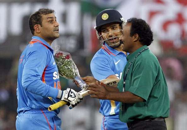 Virender Sehwag of India is congratulated with flowers by a fan after scoring a double century in 2011 in Indore