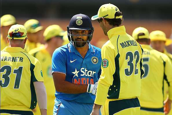 Australian players congratulate Rohit Sharma of India at the end of the innings