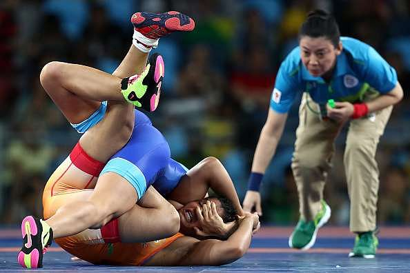 RIO DE JANEIRO, BRAZIL - AUGUST 17:  Sakshi Malik (R) of India competes against Valeriia Koblova Zholobova of Russia during a Women