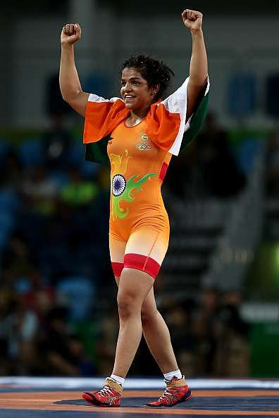 RIO DE JANEIRO, BRAZIL - AUGUST 17:  Sakshi Malik of India is declared the winner against Aisuluu Tynybekova of Kyrgyzstan during the Women