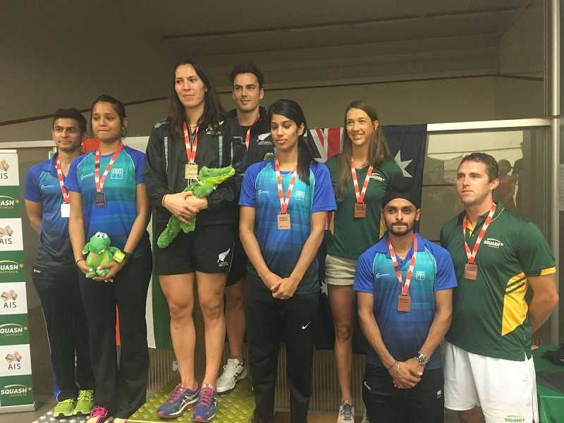 The Indian players on the podium during WSF World Doubles Twitter)the mixed doubles medal ceremony (image courtesy: